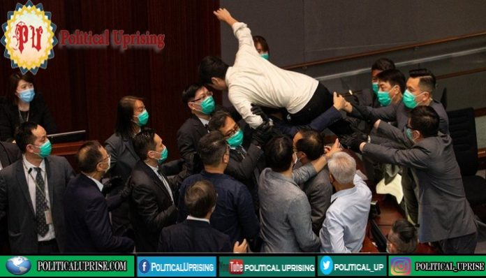 Pro-democracy lawmakers in Hong Kong dragged out of legislative session