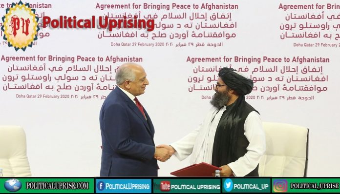Afghan Taliban call on Biden to stick to February agreement
