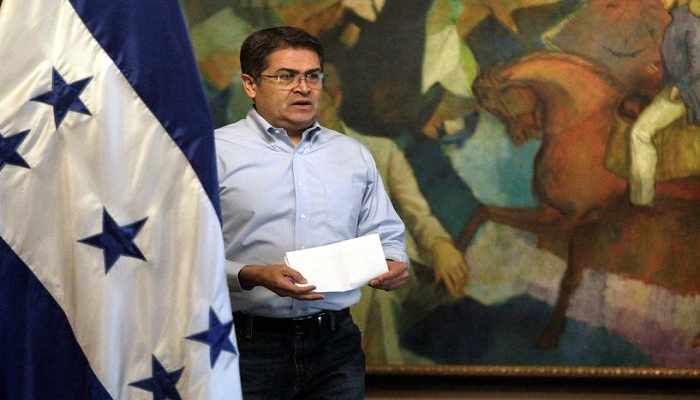 Honduran president denies allegation while trial says he accepted bribes