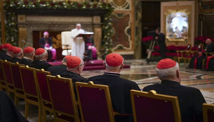 Pope Francis orders cardinals and clerics to take a 10% pay cut