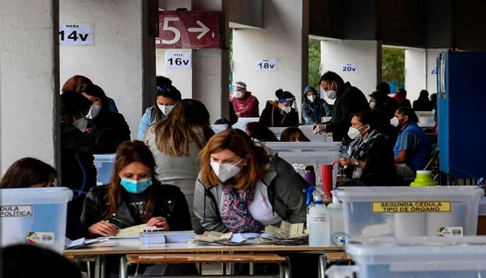 Chileans vote to elect delegates, will rewrite country's dictatorship-era constitution